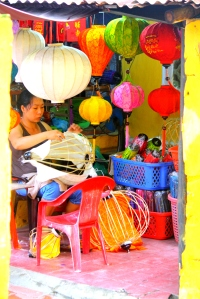 A woman making lantern